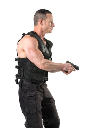 Man with tactical vest and gun isolated in white Stock Photo