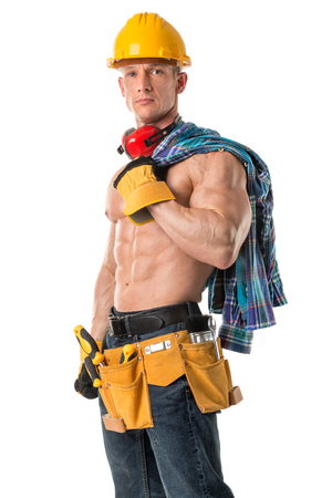 Power shirtless athletic construction worker showing great phisique. Imagens