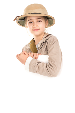 Young girl with safari costume isolated in white