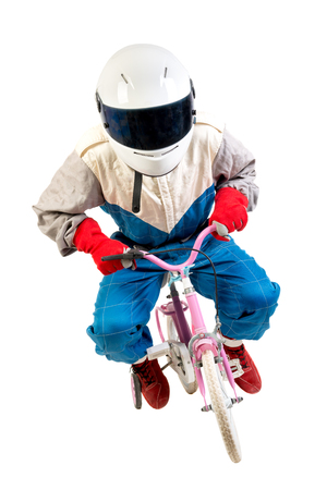 Racing driver posing with young girls pink bicycle isolated in white