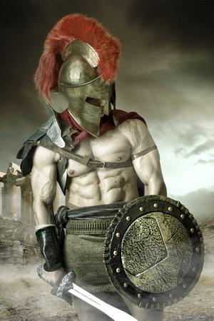 Ancient warrior or Gladiator posing outdoors with helmet Banco de Imagens