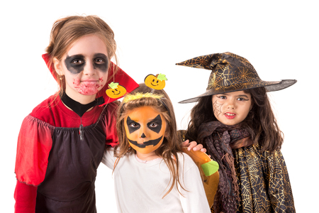 trick or tread: Group of kids with face-paint and Halloween costumes  Stock Photo