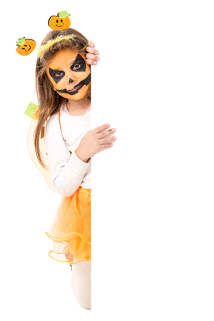 Girl with face-paint and Halloween pumpkin costume isolated in white