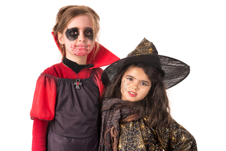 Kids posing in Halloween costumes isolated in white