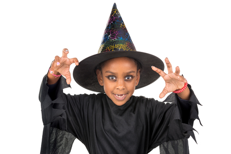 Girl in Halloween witch costume over a white background Imagens