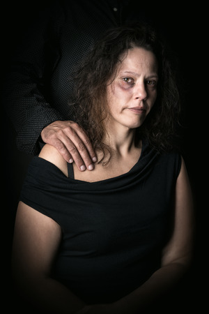 Abused woman with husband, victim of domestic violence Stock Photo