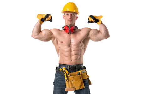 Power shirtless athletic construction worker showing great phisique. Stock Photo