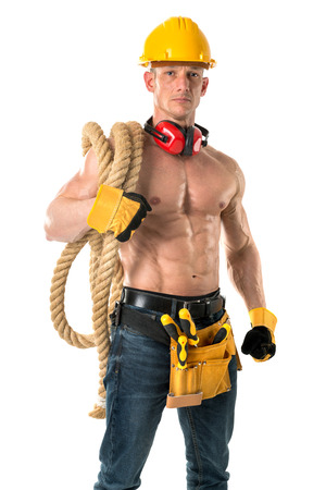 build in: Strong build construction worker with big rope isolated in white Stock Photo