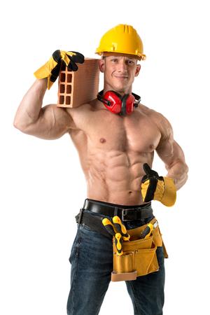 Power shirtless atletische bouwvakker met een baksteen Stockfoto