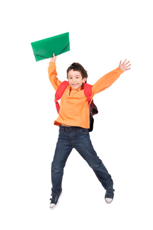 Young boy student jumping isolated in white