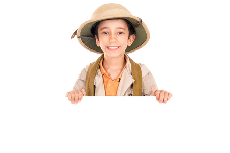 Young boy with Safari clothes behind a white board isolated in white