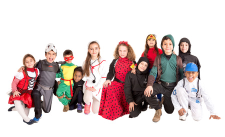 trick or tread: Group of kids in HalloweenCanaval costumes isolated