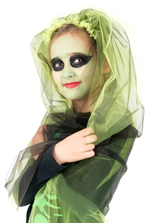 Girl with face-paint and Halloween witch costume over a white background