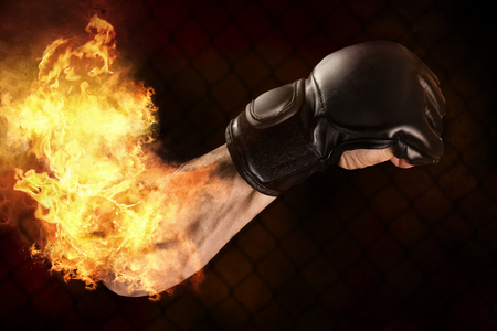 Mixed Martial Arts fighters arms with fire