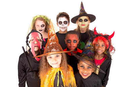 Kids with face-paint and Halloween costumes isolated in white Фото со стока - 87426741