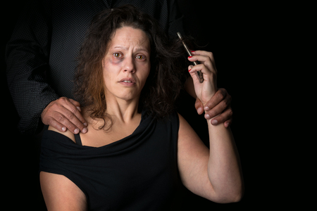 Abused woman victim of domestic violence, calling for help