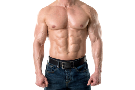 Power athletic man with great physique. Strong bodybuilder showing perfect body isolated in white. Stock Photo