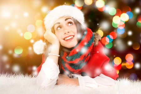 Happy and beautiful girl with freckles in Christmas with snow flakes Stock Photo