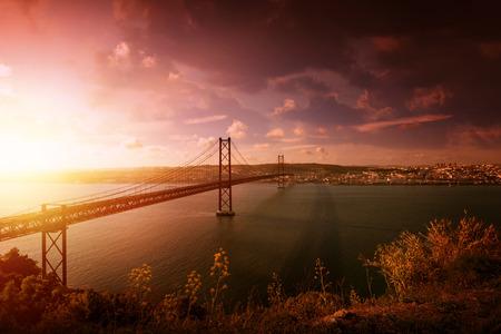 25 de Abril bridge in Lisbon Portugal at sunset