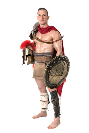 Ancient warrior or Gladiator posing over a white background Stock Photo