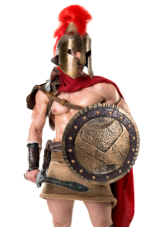 Ancient warrior or Gladiator posing over a white background