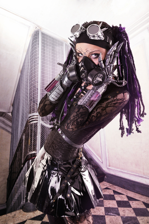 Cyber Gothic girl posing in a grunge victorian background