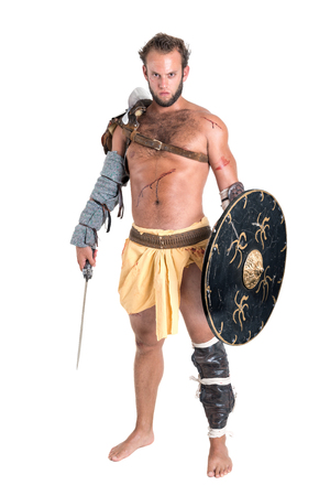 Ancient warrior or Gladiator isolated in a white background Stock Photo
