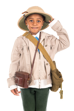 Young boy with a camera playing Safari isolated in white Stock Photo