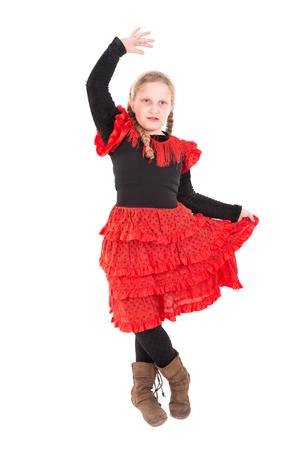 白で孤立したスペインのダンサーの衣装を着たYounの女の子