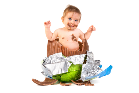 Sweet baby inside an Easter egg isolated in white