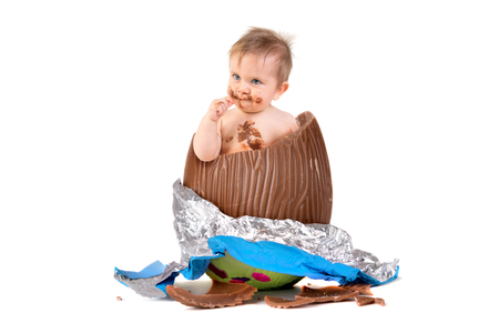 Sweet baby inside an Easter egg isolated in white Stock Photo - 93688575