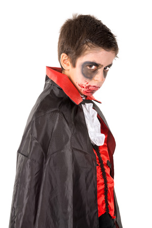 Boy with face-paint and vampire Halloween costume isolated in white