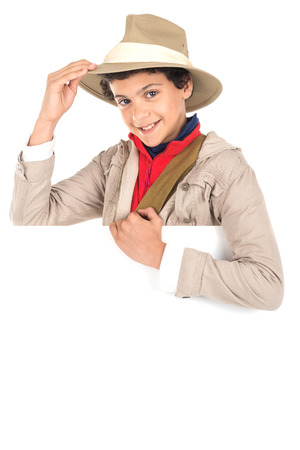 Young boy with Safari clothes behind a white board isolated in white background Imagens