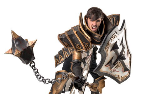Young man cosplaying with fantasy knight costume 写真素材