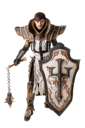 Young man cosplaying with fantasy knight costume Banco de Imagens