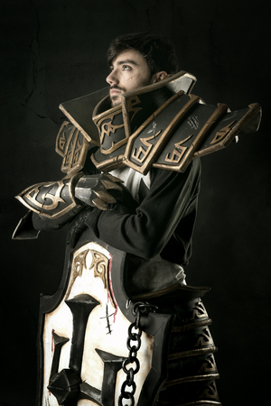 Young man cosplaying with fantasy knight costume Stock Photo