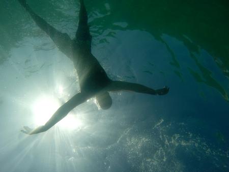 Man drowning viewed from below underwater Foto de archivo