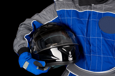 Racing driver body-part with helmet isolated in black Stock Photo