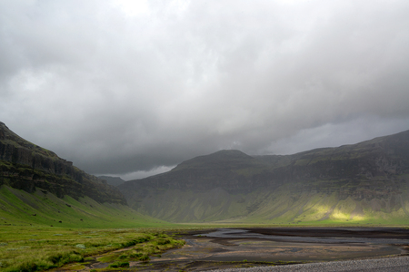 Beautiful landscape of Icelandic mountain with cloudy sky
