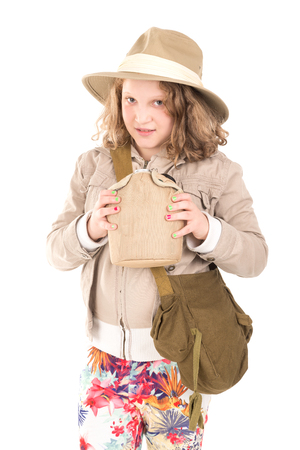 Young girl with Safari clothes and canteen isolated in white