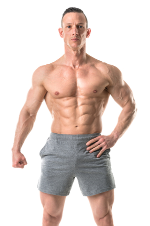 Power athletic man with great physique. Strong bodybuilder with six pack, perfect abs, shoulders, biceps, triceps and chest isolated in a white background