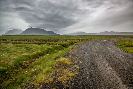 Empty road with cloudy skies in wild Iceland