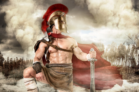 Ancient warrior or Gladiator posing outdoors with helmet Stock fotó