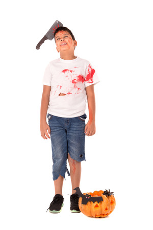 Boy in Halloween costume with pumpkin over a white background 스톡 콘텐츠 - 105709207