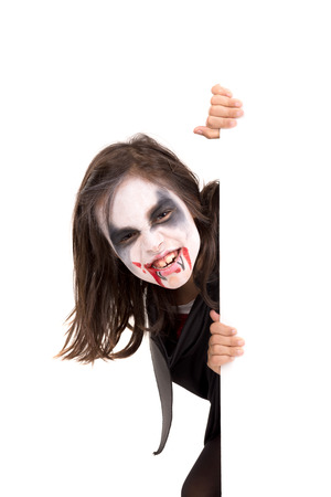 Girl with face-paint and Halloween vampire costume over a white board