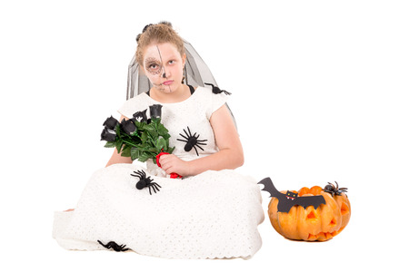 Girl with face-paint and Halloween costume isolated in white Imagens