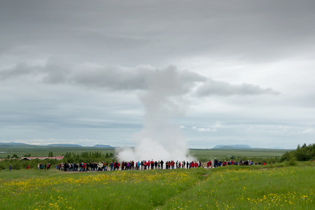 Strokkur geysir blowing high, Iceland in June