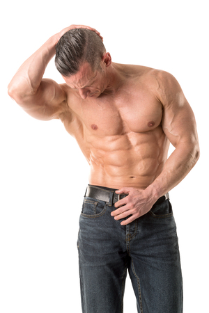 Power athletic man with great phisique. Strong bodybuilder with six pack, perfect abs, shoulders, biceps, triceps and chest isolated in a white background