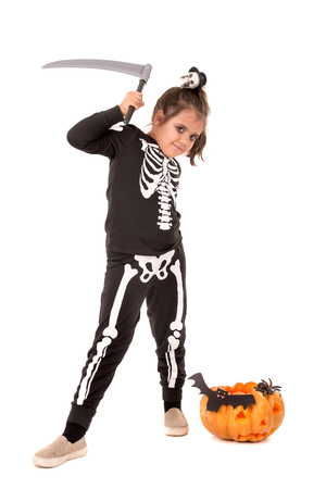 Girl in Halloween costume with pumpkin over a white background