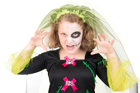 Girl in Halloween costume over a white background